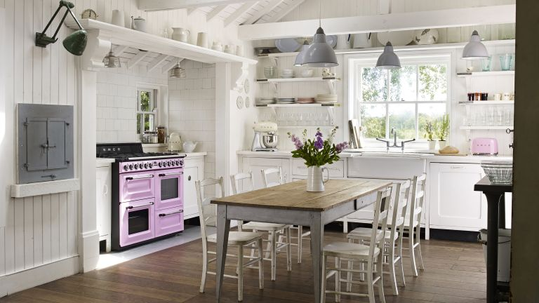 Traditional kitchen idea by Smeg with pink appliances