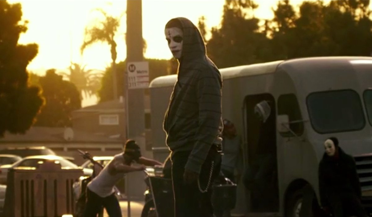 A Purger skateboarding in The Purge: Anarchy.