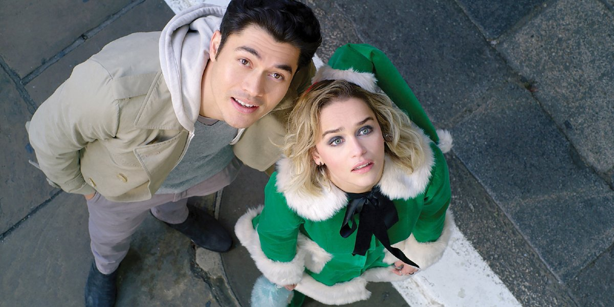 Last Christmas Henry Golding and Emilia Clarke looking up at the sky
