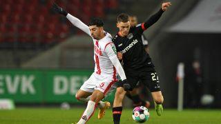 Bayer Leverkusen player Florian Wirtz on the ball