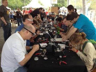 People of all ages learn how to solder at World Maker Faire in New York on Sept. 21, 2013.
