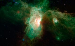 The Horsehead Nebula's dusty shape all but disappears in infrared wavelengths, as seen in this image from NASA's Spitzer Space Telescope.