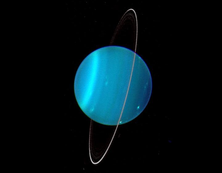 What smacked Uranus on its side? Something icy and as massive as Earth, scientists say.