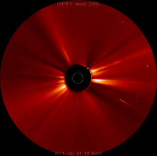 Soon after a huge solar storm erupted on May 20-21, 2011, a comet (bright streak at lower right) plunged into the sun. This shot is a still from a video taken by one of NASA's twin STEREO spacecraft.