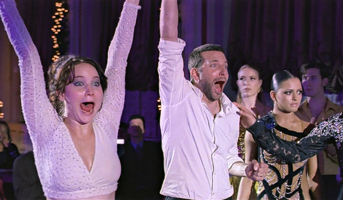 Jennifer Lawrence and Bradley Cooper celebrate good news in Silver Linings Playbook.