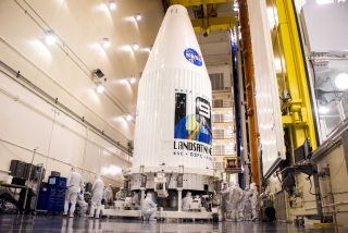 NASA's new Landsat 9 Earth-observation satellite is secured inside its payload fairing for a planned September 2021 launch into orbit on a United Launch Alliance Atlas V rocket from the Vandenberg Space Force Base in California.