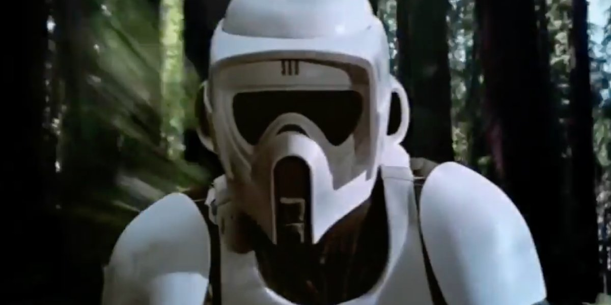 A scout trooper tries to outrun Luke and Leia on a speeder bike in Star Wars: Return of the Jedi