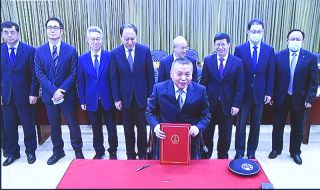 An image shared by the China National Space Administration (CNSA) shows director Zhang Kejian (front) during the signing of the memorandum of understanding between China and Russia to build a shared facility on the moon.