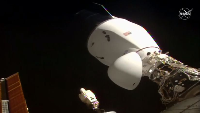 SpaceX's 1st upgraded Dragon cargo ship docks itself at space station with science, goodies and new airlock
