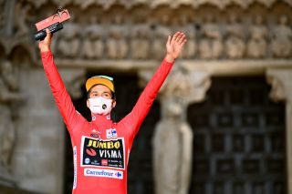 BURGOS SPAIN AUGUST 14 Primoz Roglic of Slovenia and Team Jumbo Visma celebrates winning the red leader jersey on the podium ceremony after the 76th Tour of Spain 2021 Stage 1 a 71km individual time trial from Burgos Catedral de Santa Mara to Burgos lavuelta LaVuelta21 CapitalMundialdelCiclismo catedral2021 on August 14 2021 in Burgos Spain Photo by Stuart FranklinGetty Images
