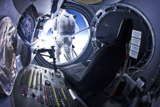 Baumgartner Leaps from Capsule During Test Jump
