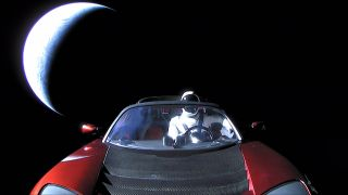 """A Tesla Roadster and a mannequin """"driver"""" were launched into space by a SpaceX Falcon Heavy rocket on Feb. 6, 2018. The Roadster came equipped with cameras to show the view from orbit."""