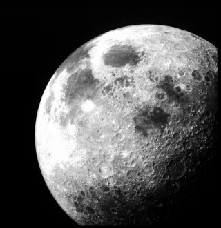 After Apollo 12 left lunar orbit this image of the moon was taken from the command module on Nov. 24, 1969.