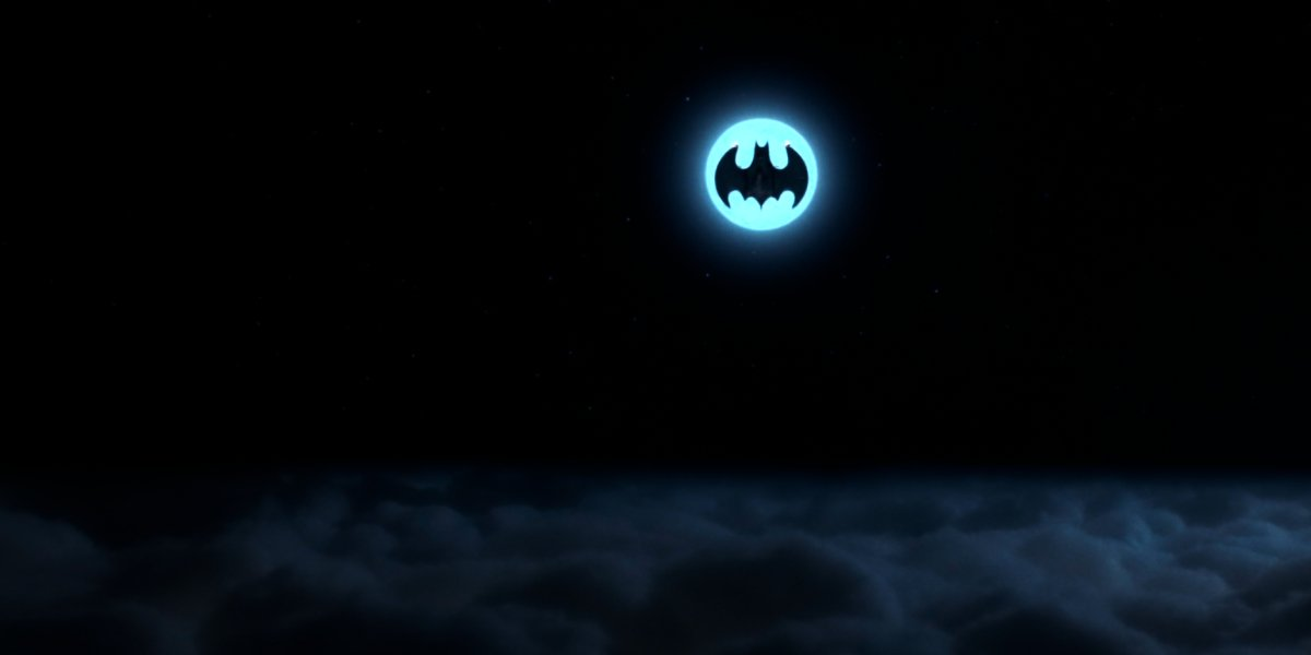 The Batwing in front of the moon from Batman