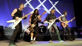 Metallica's James Hetfield, Robert Trujillo, Diamond Head's Brian Tatler, and Kirk Hammett at Day One of the bands' 30th Anniversary shows at The Fillmore on December 5, 2011 in San Francisco