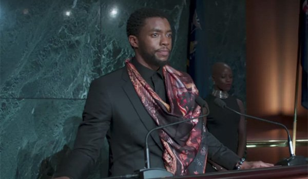 Chadwick Boseman in regular Wakanda clothes in Black Panther