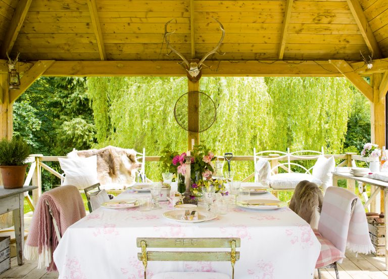 alfresco dining area with florals and linens