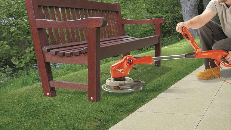 Flymo Contour 500E Electric Grass Trimmer and Edger in use under bench