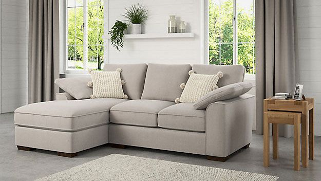 grey corner sofa in contemporary living room by m&s