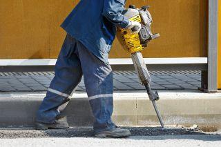 Worker jackhammering (shutterstock)