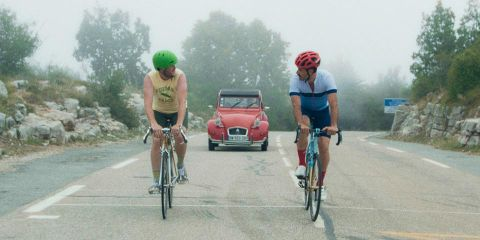Michael Angelo Covino and Kyle Marvin riding bikes in 'The Climb.'
