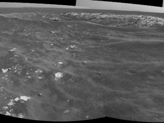 "NASA's Mars Exploration Rover Opportunity recorded this view of a crater informally named ""Freedom 7."" The image combines two frames that Opportunity took with its navigation camera on May 2, 2011."