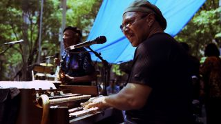 Art Neville with Charles Neville performing with the Neville Brothers in Brooklyn, New York on 22 July 2004
