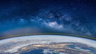 fish-eye lens photo of planet Earth from above with field of stars in the backgorund
