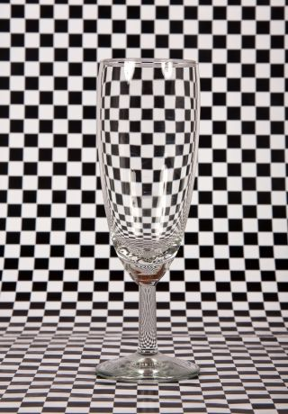 a checkerboard background with a wineglass.