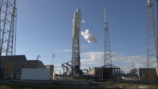 A SpaceX Falcon 9 rocket carrying the DSCOVR space weather satellite is fueled for a Feb. 8, 2015 launch attempt that was aborted due to an Air Force radar malfunction. SpaceX now plans to launch the mission on Tuesday, Feb. 10.