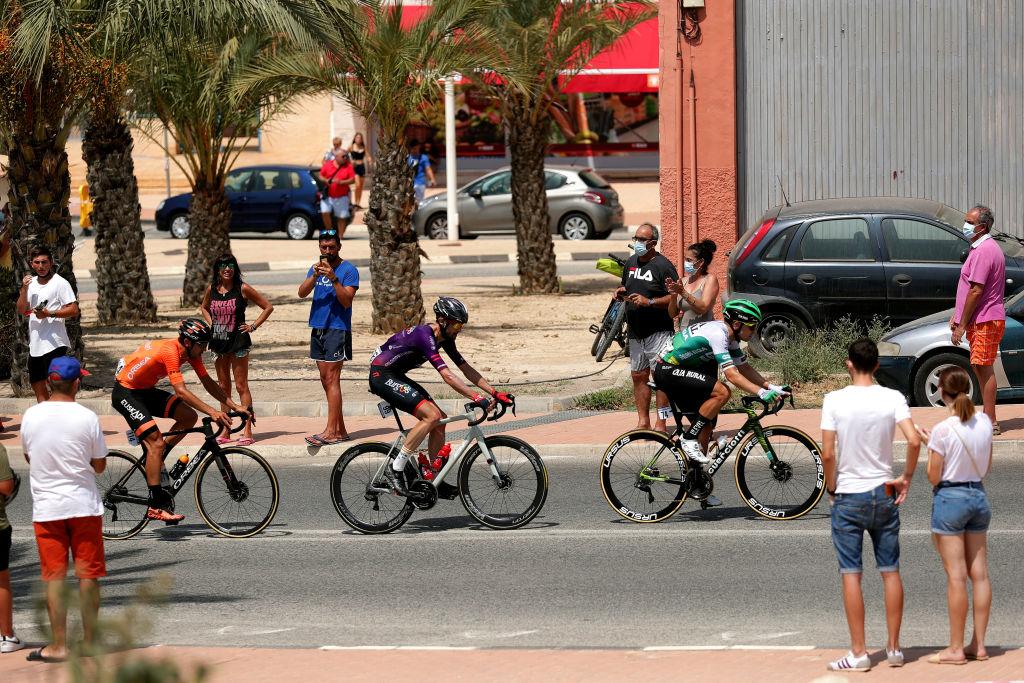 Ander Okamika (Burgos-BH), Aritz Bagues (Caja Rural-Seguros RGA) and Mikel Iturria (Euskaltel-Euskadi) ride through the crowds at the 2021 Vuelta a España