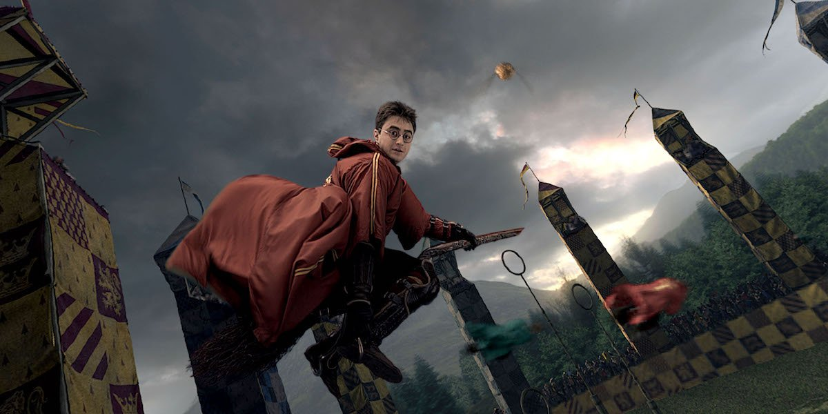 Daniel Radcliffe as Harry Potter playing Quidditch