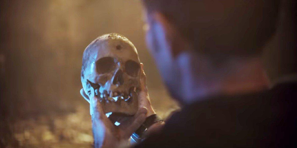 Manolo Cardona holding a skull in Who Killed Sara
