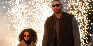 My Spy Chloe Coleman and Dave Bautista walk away from an explosion