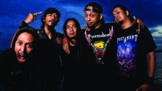 Burgerkill standing together near the sea