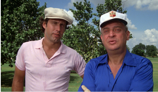 Caddyshack Chevy Chase Rodney Dangerfield admiring a golf shot with a joke
