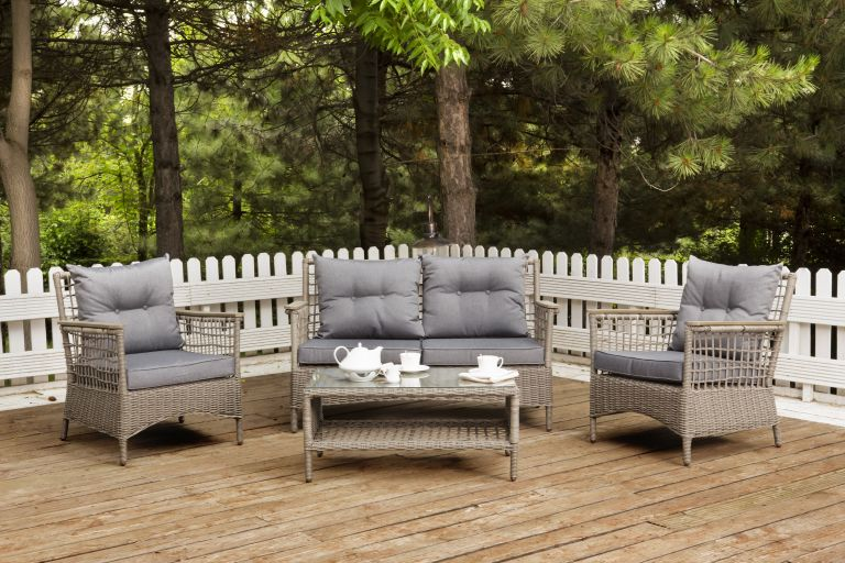 decking railing ideas: outdoor seating surrounded by white deck fence