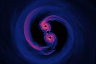 This visualization shows two merging black holes, whose great speed could provide a boost to laser light swinging around them.