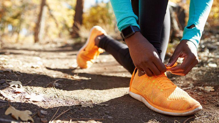 best running watch: Runner tying their laces