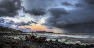 ship wreck and storm against the sunset