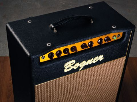 The front panel features classy oxblood control knobs on a gold anodised chassis