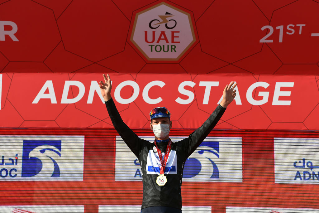 ABU DHABI UNITED ARAB EMIRATES FEBRUARY 21 Podium Joao Almeida of Portugal and Team Deceuninck QuickStep Black Intermediate Sprint Jersey Celebration during the 3rd UAE Tour 2021 Stage 1 a 176km stage from Al Dhafra Castle to Al Mirfa Mask Covid Safety Measures UAETour on February 21 2021 in Abu Dhabi United Arab Emirates Photo by Tim de WaeleGetty Images