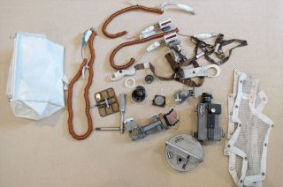 """Found only after this death in 2012, Neil Armstrong had hidden in his closet the Apollo 11 """"McDivitt purse"""" (at left) and its contents of flown-to-the-moon lunar module parts."""