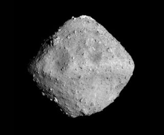 This image of asteroid Ryugu was taken June 26, 2018, by the Hayabusa2 probe's optical navigation camera, just a day before the probe's rendezvous with the space rock. The image was taken at about 14 miles (22 km) away from the asteroid.