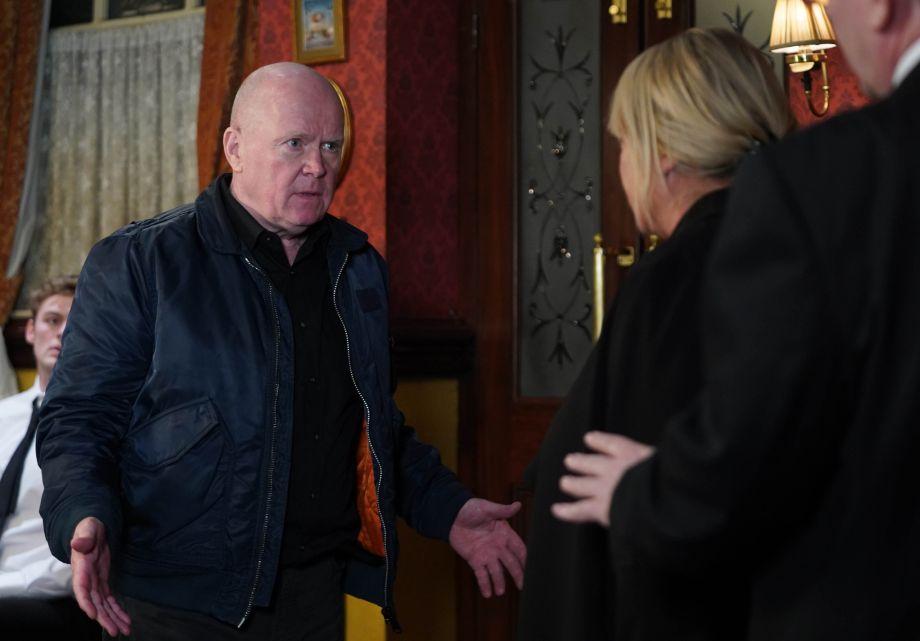 Phil arrives at Dennis's wake in EastEnders