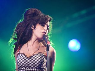 Winehouse says her new album will be out in six months. Her producer isn't so sure