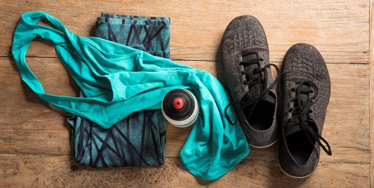 fitness sports clothes and shoes on a wooden floor