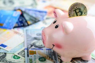 Bitcoin in a piggy bank.