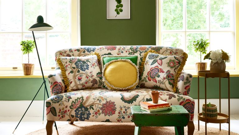 Faded floral printed sofa by Linwood
