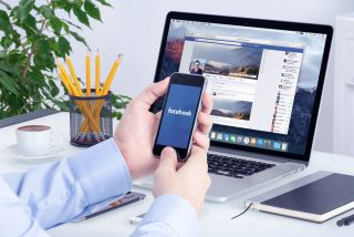 Facebook on a smartphone and a MacBook at the same time.